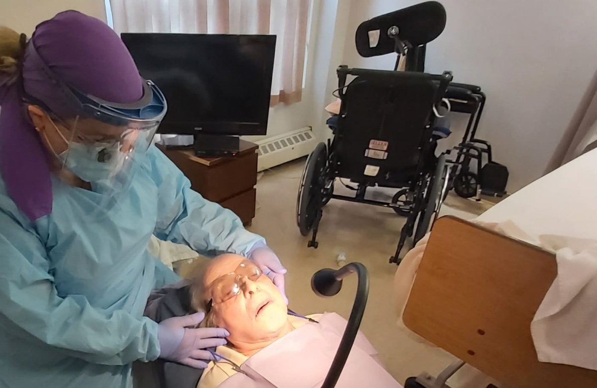 Elderly dental patient treated by Dental Care in Motion
